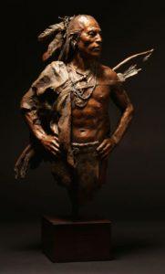 John Coleman Unvanquished Native American man bronze sculpture Briscoe Museum