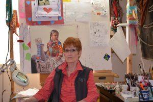 Ann Hanson working in studio artist