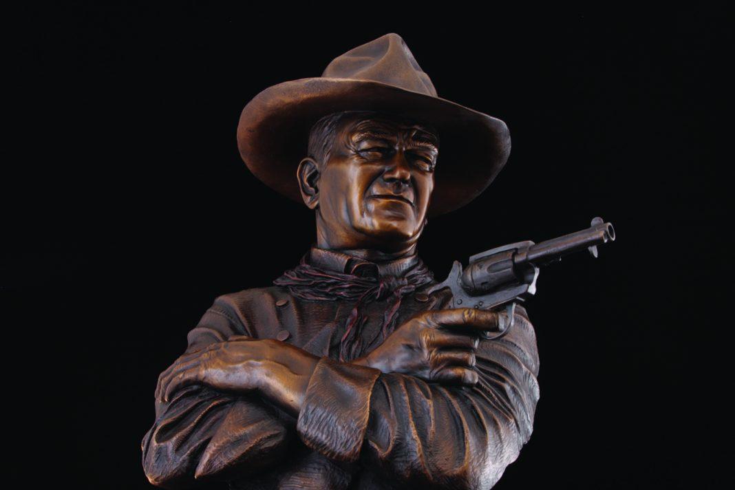 Michael Trcic Out Here A Man Settles His Own Problems John Wayne cowboy gun firearm pistol western bronze sculpture close up